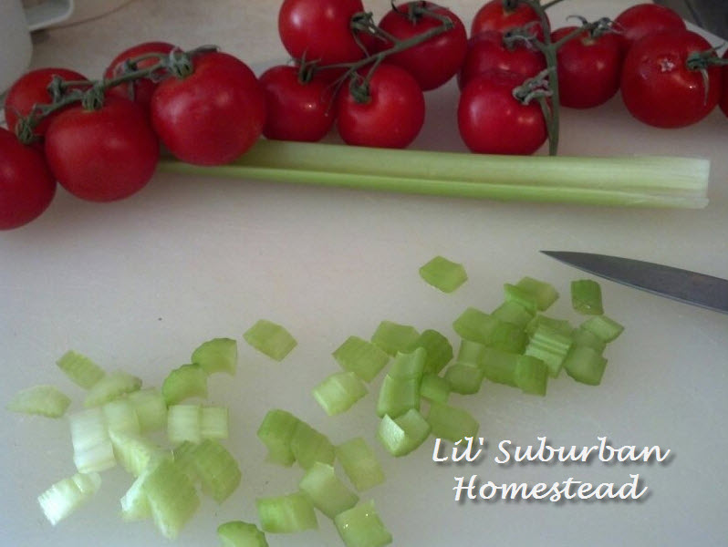 chopping up celery for chicken salad