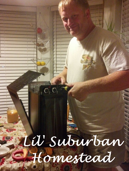 my husband repairing the toaster